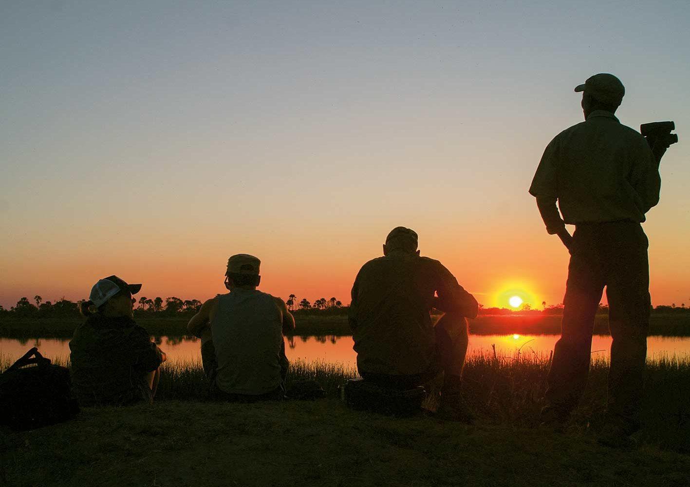 Sundowner im Okawango-Delta, Botswana